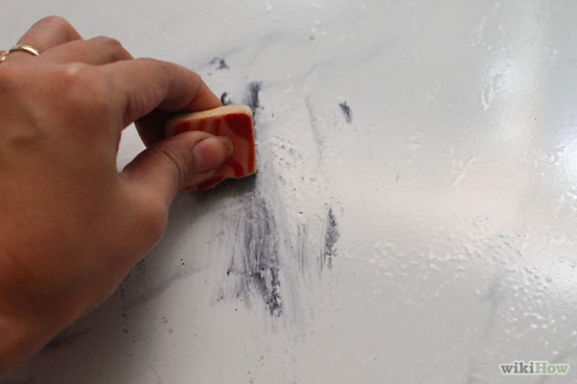 rubber to remove black stains like soil from the floor hard to reach places