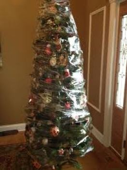 8 Christmas Tree Tips Everyone Should Know the handy mano manomano mano diy do it yourself christmas festive timesaving hacks hack tree decoration cling film wrap neat clean tidy protected tree