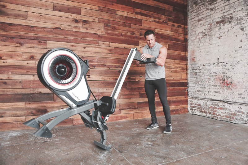 Male Model folding the Marcy Turbine Air Rower   NS-6050RE Foldable Rower