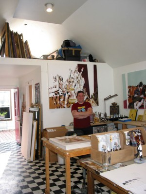 Ian Shults in his studio with one of his lucious paintings.