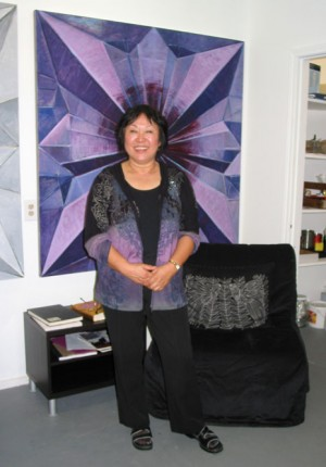 Chun Hui Pak with one of her origami inspired paintings in her studio at Big Medium.