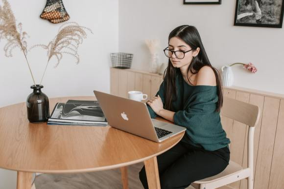support your etsy shop - woman using laptop