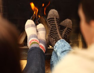 feet with socks resting by the fire