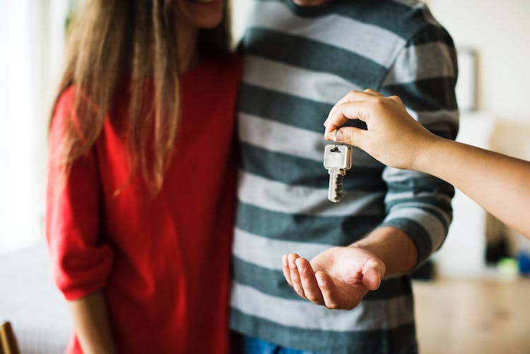 Buyers getting keys to a home.