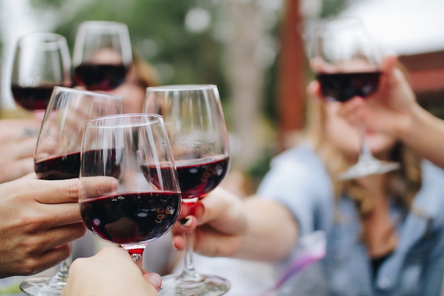 People drinking wine.