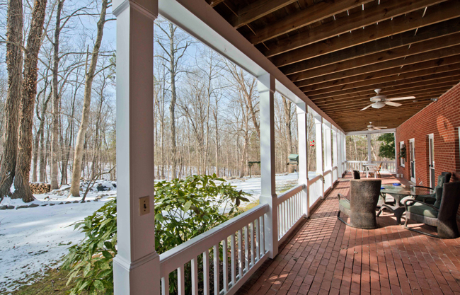 Relaxing long porch with railing