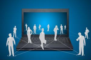 Silhouettes of people emerge from a laptop.