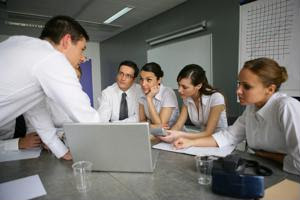 A team of employees discusses ideas at a meeting.