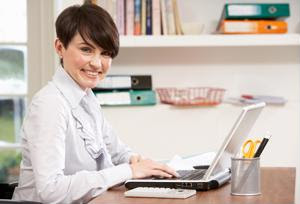 An employee uses a laptop at home.