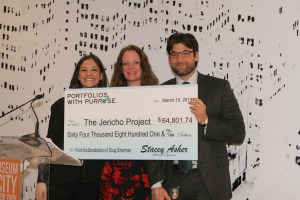 Portfolios With Purpose founder Stacey Asher (left) presents a check to the Jericho Project.