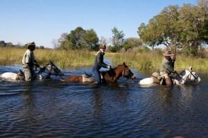 Equitrekking host Darley Newman riding in Botswana's Okavango Delta.