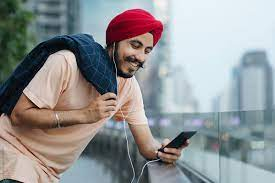 man in India listening music on smartphone
