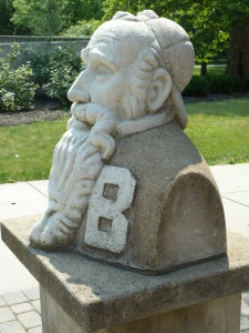 Menno Simons boasts a baseball hat on a stand in a plaza at Bluffton University, Bluffton, Ohio, where the Historian attended a one-day technology conference.