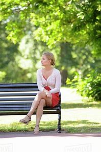 Seated on a park bench