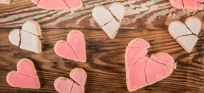 Broken heart sugar cookies sitting on table