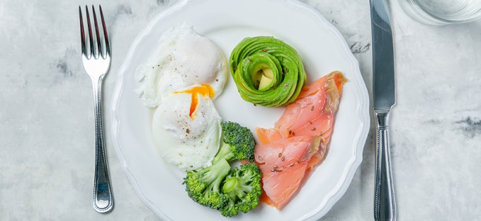 Eggs, Avocado, Salmon and Broccoli on a dinner plate
