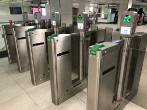 Image shows a line of TTC gates, with PRESTO readers.