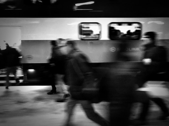 In flashes and blurred, customers are seen rushing to catch their trains.