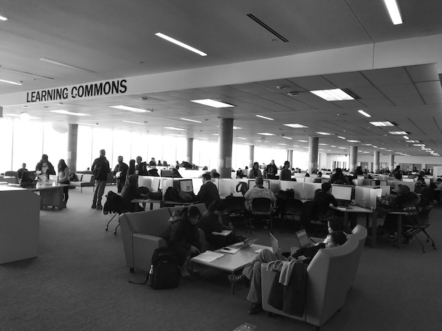 Students sit at desks and in lounge chairs at Humber college.
