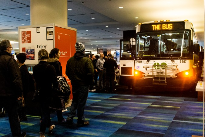 Crowds line up to see inside the GO bus at the International AutoShow.