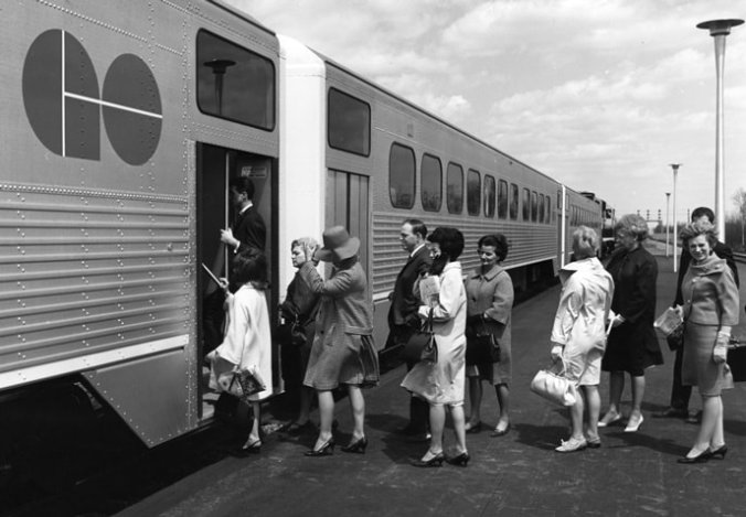 Men and women line up on the platform, while they board a sleep GO train.