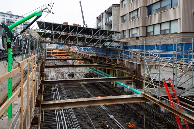 Metal supports and rebar line the subsection of construction work.