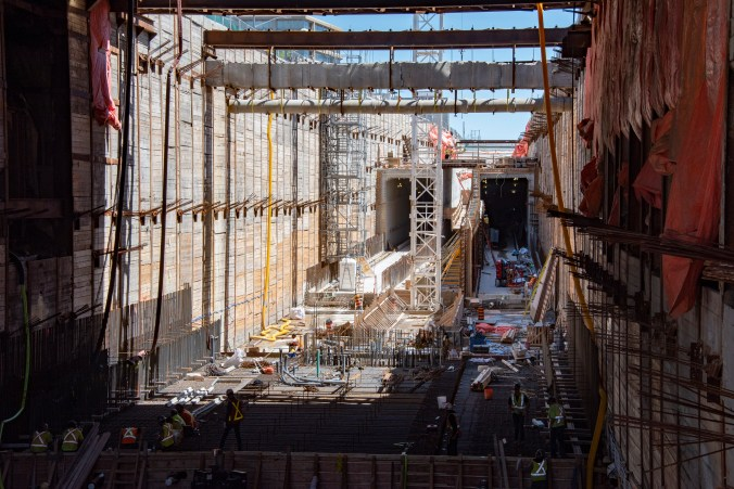 The construction site is shown with its many levels of wood and concrete and steel levels.