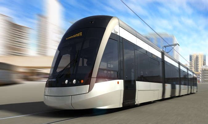An artist concept of a sleek and long light rail transit vehicle, with a black and white exterior.