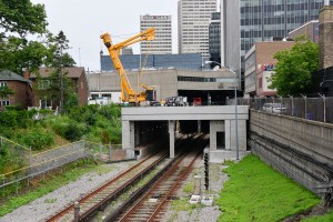 The image shows equipment working above a section of tunnel.