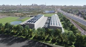 A rendering shows a large building, with rows of solar panels on top.
