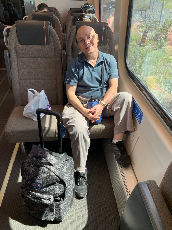 Moses Saybe sits on an UP Express seat.