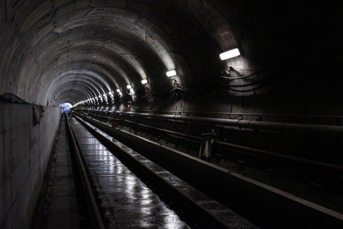 In black and white, the image shows a long tunnel section.