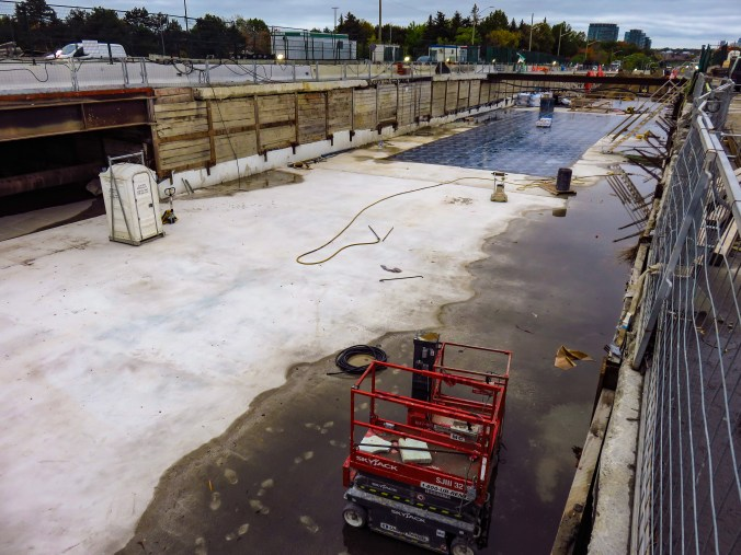 A view down at the foundation of Science Centre station, which is getting waterproofing added.