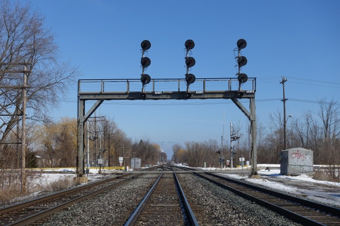 A photo of the Lakeshore East GO line at track level looking into the distance.
