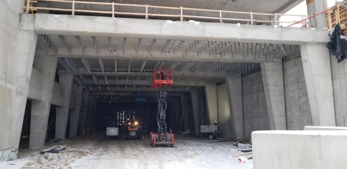 Crews work on the inside of a bus shelter.