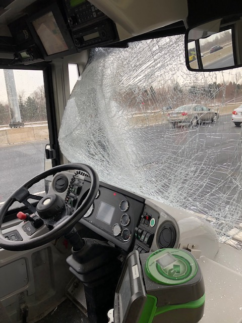 The image shows the windshield smashed in.