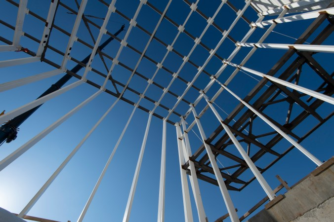 Image looks up a web of steel beams.