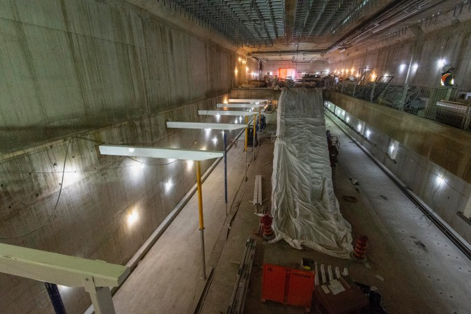 Image shows the inside of the Science Centre, with large concrete walls and building equipment.