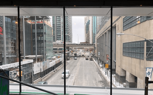 Looking out windows to the street below.