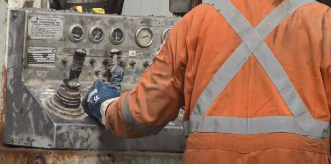 The back of a crew member is shown, as controls are moved.