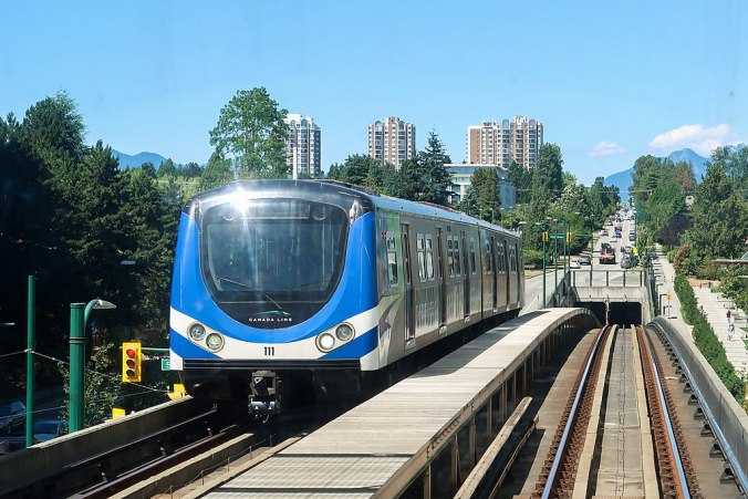 A Canada Line metro train on a track in Vancouver