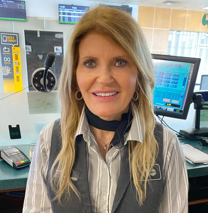 GO station attendant Dana Fisher sitting at her computer