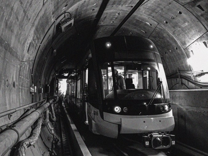 An LRV waits inside a tunnel.