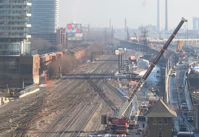 Image shows the crane beside the rail tracks.