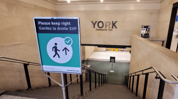 New signage that directs the flow of people at Union Station