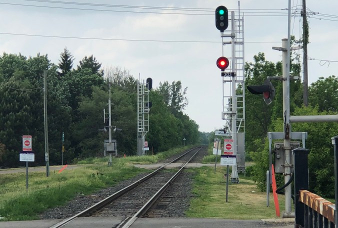 A level crossing with signal tower indicators in the background