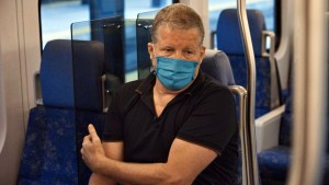 Image shows Phil Verster sitting on a GO train