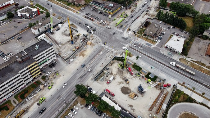Image looks down on the site from high above. Shows streets and traffic site.
