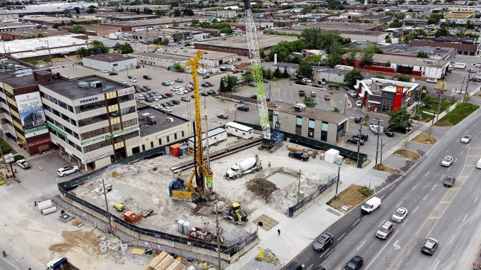 Image shows a drilling machine in the middle of the work site.