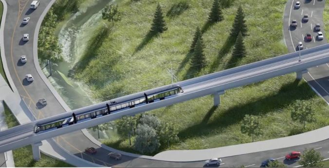 Imagwe shows an LRT on tracks over a highway.